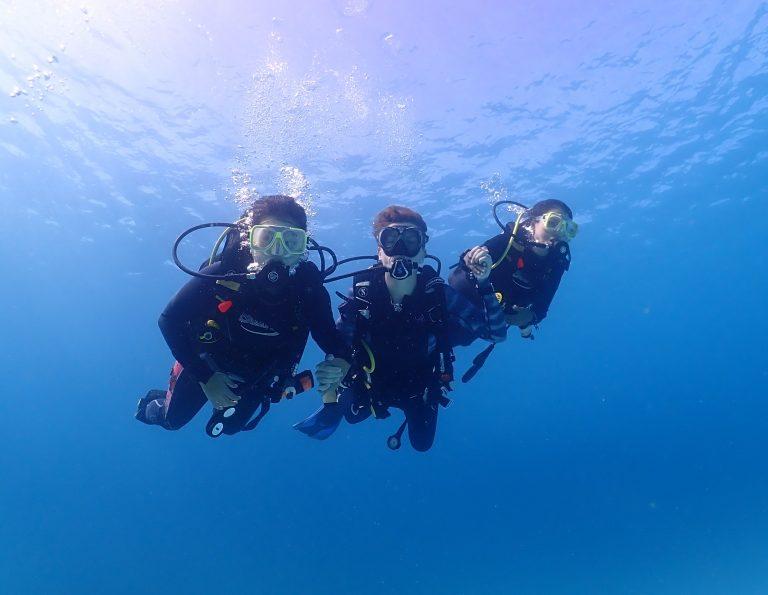 Three divers underwater
